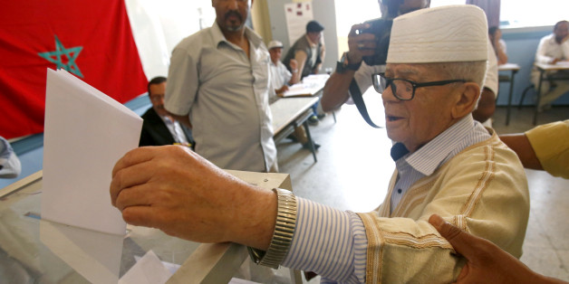 A man casts her ballot at a polling station for the parliamentary elections, in  Rabat, Morocco, Friday, Oct. 7, 2016. Millions of Moroccans hit the voting booths, with worries about joblessness and extremism on many minds as they choose which party will lead their next government.(AP Photo/Abdeljalil Bounhar)