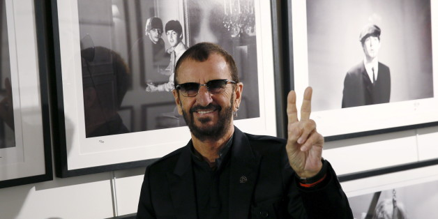 "Musician Ringo Starr poses in front of some of his photographs during a media event as he launches his book ""Photograph"" at the National Portrait Gallery in London, Britain, September 9, 2015. REUTERS/Stefan Wermuth"