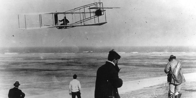 In this undated file photo, Orville and Wilbur Wright test their airplane on a beach. The Wright brothers have long been credited as the first to achieve powered flight. But in June, 2013, Connecticut Gov. Dannel P. Malloy signed a law giving German-born aviator and Connecticut resident Gustave Whitehead the honor of being first. On Thursday, Oct. 23, 1013 Ohio state Rep. Rick Perales and North Carolina state Sen. Bill Cook held news conferences to dispute Connecticut's action and reassert the W