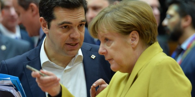 BRUSSELS, BELGIUM - MARCH 18: Greek Prime Minister Alexis Tsipras (L) and German Chancellor Angela Merkel (R) attend the Turkey-EU Heads of State or Government summit as part of the European Union Leaders Summit in Brussels, Belgium on March 18, 2016. 
