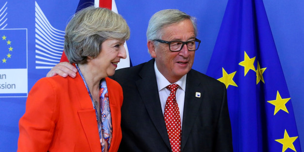 British Prime Minister Theresa May (L) is welcomed by European Commission President Jean-Claude Juncker at the EC headquarters in Brussels, Belgium October 21, 2016. To match Insight BRITAIN-EU/MESSAGES   REUTERS/Yves Herman/File Photo