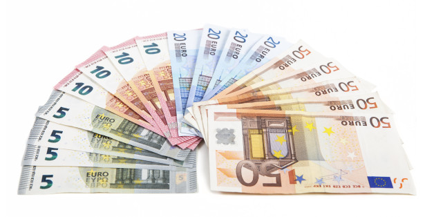 different euro bank notes fanned side by side, white background