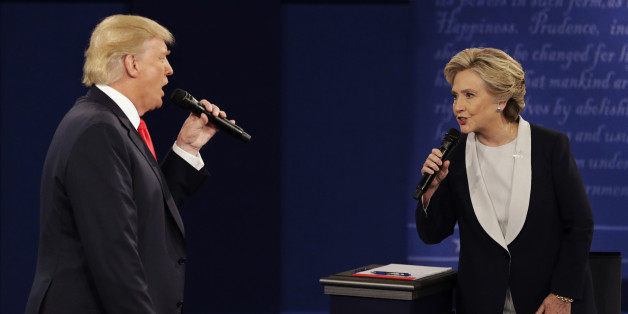 FILE - In this Sunday, Oct. 9, 2016, file photo, Republican presidential nominee Donald Trump and Democratic presidential nominee Hillary Clinton speak during the second presidential debate at Washington University in St. Louis. Trump gets outsized attention for what he's tweeting and retweeting on a near-daily basis. But Clinton has a formidable digital media army, her own app and a rapid response team ready to blast out shareable soundbites from convention speeches, photos, videos and even temporary location-specific Snapchat filters mocking Republicans. (AP Photo/John Locher, File)