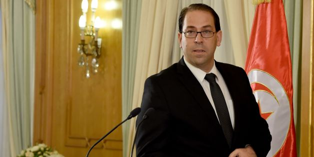 Tunisia's premier-designate Youssef Chahed speaks during a press conference to present his proposed new unity government list after he submitted it to the president on August 20, 2016 in Carthage, near the capital Tunis. 