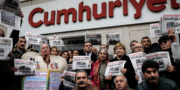 Protesters hold copies of the latest edition of the Turkish daily newspaper 'Cumhuriyet' during a demonstration in support to the Cumhuriyet in front of its headquarters in Istanbul on November 1, 2016. Turkish police on October 31, 2016, detained the editor-in-chief of the newspaper Cumhuriyet -- a thorn in the side of President Recep Tayyip Erdogan -- as Ankara widens a crackdown on opposition media. The Cumhuriyet, which had published revelations embarrassing for the government, said at least