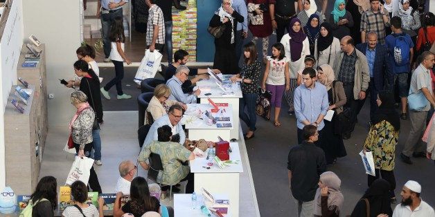 People look at books on November 1, 2016 during the 21em International Book Fair of Algiers (SILA) and Exhibition Centre in Algiers, Algeria. (Photo by Billal Bensalem/NurPhoto via Getty Images)