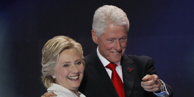 Democratic presidential nominee Hillary Clinton stands with her husband, former president Bill Clinton, after accepting the nomination on the final night of the Democratic National Convention in Philadelphia, Pennsylvania, U.S. July 28, 2016. REUTERS/Mike Segar