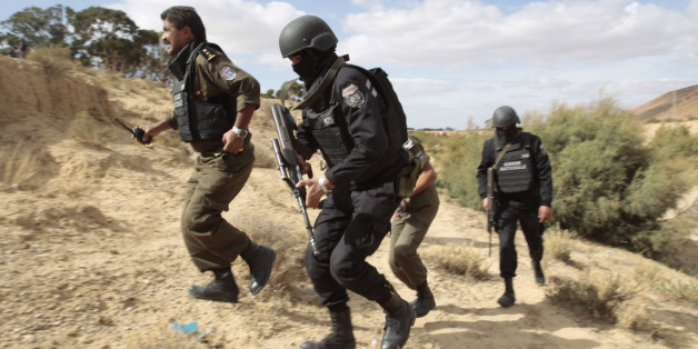 Tunisian police patrol a mountain in Kasserine October 23, 2014. The Chaambi, Saloum and Sammama mountains bordering with Algeria have become a refuge for militant groups over the past two years, turning Kasserine into a military barracks encircled by roadblocks to curb attacks. Picture taken October 23. To match story TUNISIA-ELECTION/ REUTERS/Zoubeir Souissi (TUNISIA - Tags: POLITICS CIVIL UNREST)