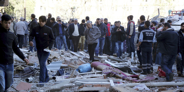 People view the damage from an explosion in southeastern Turkish city of Diyarbakir, early Friday, Nov. 4, 2016. A large explosion hit the largest city in Turkey's mainly Kurdish southeast region on Friday, wounding several people, the state-run Anadolu Agency reported. Turkish authorities have imposed a temporary blackout on coverage of the blast occurred in Diyarbakir on Friday, citing public order and national security reasons. (AP Photo/Mahmut Bozarslan)
