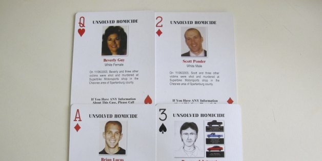 FILE - In this Oct. 24, 2013 file photo, details of a quadruple homicide are included on these playing cards passed out to inmates in South Carolina prisons, in Spartanburg, S.C. The cards were created by Tom Lucas, whose son, Brian, was killed in the unsolved shootings of four people inside a motorcycle shop in Spartanburg County on Nov. 6, 2003. Officials say the man arrested after authorities found a woman chained on his property in rural South Carolina killed four people and 3 other bodies were found on his property. Sheriff Chuck Wright said Saturday, Nov. 5, 2016, that his confession solved a 13-year-old case. Todd Christopher Kohlhepp confessed he was the shooter who killed four people at the motorcycle shop in Spartanburg County in 2003, Wright said. (AP Photo/Jeffrey Collins, File)