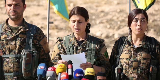 Jihan Sheikh Ahmed, a spokeswoman for the Syrian Democratic Forces (SDF), holds a press conference in the town of Ain Issa, some 50 kilometres north of Raqa, on November 6, 2016, to announce that the US-backed alliance has began a long-awaited operation to capture the Islamic State group's de facto Syrian capital Raqa. 'The major battle to liberate Raqa and its surroundings has begun,' Jihan Sheikh Ahmed said at the press conference in Ain Issa. The operation, dubbed 'The Wrath of the Euphrates,' comes as Iraqi forces backed by the US-led coalition press an assault to take the jihadist group's Iraqi stronghold of Mosul. / AFP / DELIL SOULEIMAN        (Photo credit should read DELIL SOULEIMAN/AFP/Getty Images)