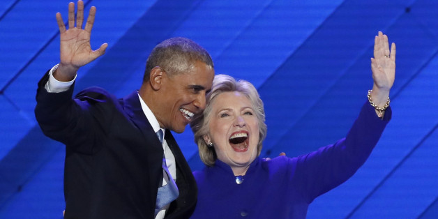 U.S. President Barack Obama and Democratic presidential nominee Hillary Clinton appear onstage together after his speech on the third night at the Democratic National Convention in Philadelphia, Pennsylvania, U.S. July 27, 2016.  REUTERS/Mike Segar