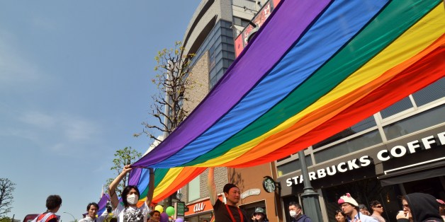 Supporters of the lesbian, gay, bisexual and transgender community (LGBT) carry a rainbow banner as they take part in the 'Tokyo Rainbow Pride' parade in Tokyo on April 27, 2014. Organisors said some 14,000 supporters of the LGBT community, many in costume, marched in Tokyo's Shibuya and Harajuku shopping districts.     AFP PHOTO / Yoshikazu TSUNO        (Photo credit should read YOSHIKAZU TSUNO/AFP/Getty Images)