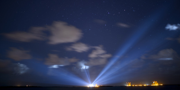 CAPE CANAVERAL, FL - SEPTEMBER 7:  In this handout photo provided by NASA, the United Launch Alliance Atlas V rocket with NASA's Origins, Spectral Interpretation, Resource Identification, Security-Regolith Explorer (OSIRIS-REx) spacecraft on board is seen illuminated in the distance in this thirty second exposure on September 7, 2016 at Cape Canaveral Air Force Station in Florida.  OSIRIS-REx is scheduled to launch on Sept. 8 and will be the first U.S. mission to sample an asteroid, retrieve at least two ounces of surface material and return it to Earth for study. The asteroid, Bennu, may hold clues to the origin of the solar system and the source of water and organic molecules found on Earth. (Photo by Joel Kowsky/NASA via Getty Images)