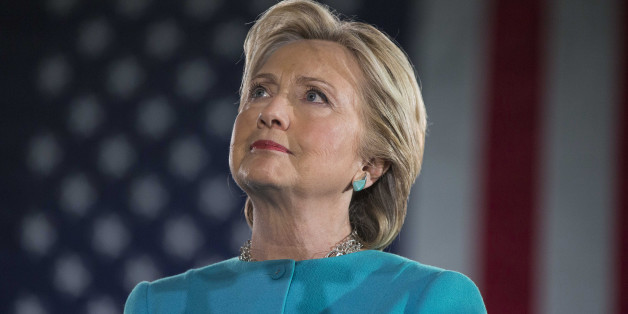Hillary Clinton, 2016 Democratic presidential nominee, listens on stage during a campaign rally in Manchester, New Hampshire, U.S., on Sunday, Nov. 6, 2016. Clinton's campaign received a major boost Sunday afternoon when FBI Director James Comey, in a letter to congressional leaders, said the agency stood by its assessment in July that the former secretary of state hadn't committed a crime in her handling of classified information through e-mail on a private server. Photographer: Scott Eisen/Bloomberg via Getty Images