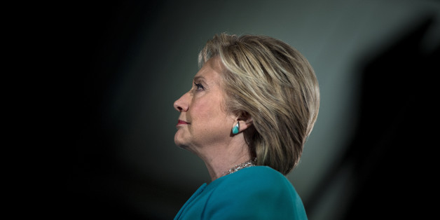 TOPSHOT - US Democratic presidential nominee Hillary Clinton waits to speak during a rally at the Armory November 6, 2016 in Manchester, New Hampshire. / AFP / Brendan Smialowski        (Photo credit should read BRENDAN SMIALOWSKI/AFP/Getty Images)