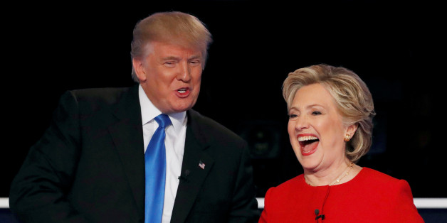 Republican U.S. presidential nominee Donald Trump shakes hands with Democratic U.S. presidential nominee Hillary Clinton at the conclusion of their first presidential debate at Hofstra University in Hempstead, New York, U.S., September 26, 2016. REUTERS/Mike Segar/File Photo