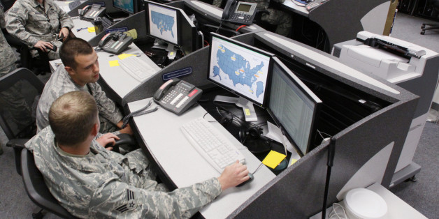 Personnel work at the Air Force Space Command Network Operations & Security Center at Peterson Air Force Base in Colorado Springs, Colorado July 20, 2010. U.S. national security planners are proposing that the 21st century's critical infrastructure -- power grids, communications, water utilities, financial networks -- be similarly shielded from cyber marauders and other foes. The ramparts would be virtual, their perimeters policed by the Pentagon and backed by digital weapons capable of circling the globe in milliseconds to knock out targets.  To match Special Report  USA-CYBERWAR/          REUTERS/Rick Wilking (UNITED STATES - Tags: MILITARY SCI TECH POLITICS)