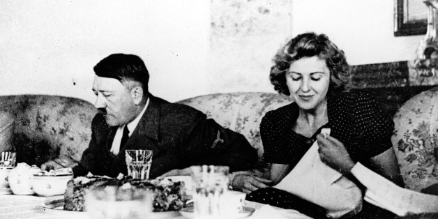 Our undated picture shows the German Fuehrer Adolf Hitler and his mistress Eva Braun while dining. (AP-Photo/Eva Braun's Album/HO)