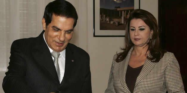 Tunisian President Zine El Abidine Ben Ali, left, casts his ballot for municipal elections, as his wife Leila Ben Ali, right, looks on, in Carthage, Tunisia, Sunday, May 9, 2010. (AP Photo/Hassene Dridi)