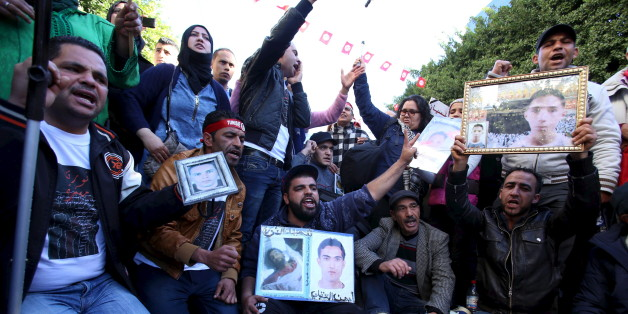 Moslem (C), a 27-year-old who was wounded while protesting during Tunisia's 2011 revolution, shouts slogans during a protest to commemorate the fifth anniversary of the revolution, in Habib Bourguiba Avenue in Tunis, Tunisia January 14, 2016. According to Moslem, he was demanding the appropriate treatment for the injuries he and other protesters received, as well as for the trial of the police officers who fired on them during the demonstrations. REUTERS/Zoubeir Souissi