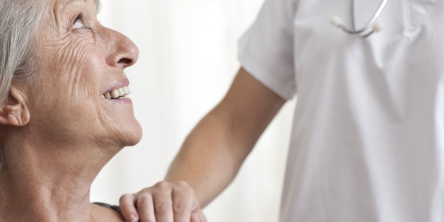 Woman being comforted by healthcare professional, cropped