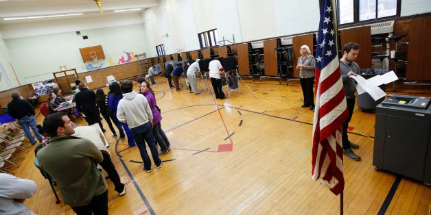 People voting at Congress Elementary School in the presidential election November 8, 2016 in Grand Rapids, Michigan. / AFP / JEFF KOWALSKY        (Photo credit should read JEFF KOWALSKY/AFP/Getty Images)