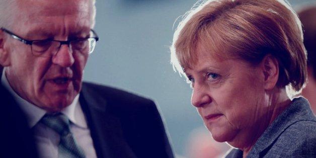 Angela Merkel umwirbt Grünen-Fraktionschefin Katrin Göring-Eckardt und den baden-württembergischen Ministerpräsidenten Winfried Kretschmann