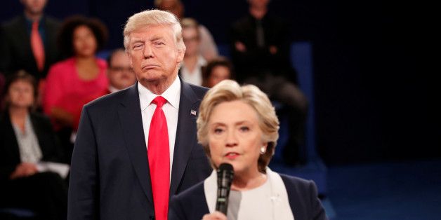 "Republican U.S. presidential nominee Donald Trump listens as Democratic nominee Hillary Clinton answers a question from the audience during their presidential town hall debate at Washington University in St. Louis, Missouri, U.S., October 9, 2016. REUTERS/Rick Wilking /File Photo                  FROM THE FILES PACKAGE ""THE CANDIDATES"" - SEARCH CANDIDATES FILES FOR ALL 90 IMAGES"