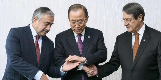 United Nations Secretary General Ban Ki-moon, center, poses with Turkish Cypriot leader Mustafa Akinci, left, and Greek Cypriot President Nicos Anastasiades at the beginning of Cyprus Peace Talks, Monday, Nov. 7, 2016, in Mont Pelerin, Switzerland. Ban is urging the rival leaders of ethnically divided Cyprus to seize the opportunity for a reunification deal that he says is within their reach. (Fabrice Coffrini/Pool Photo via AP)