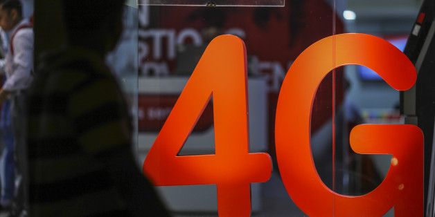 A pedestrian walks past a 4G sign displayed at a Bharti Airtel Ltd. store in Mumbai, India, on Monday, Oct. 24, 2016. Bharti Airtel is scheduled to release second-quarter earnings figures on Oct. 25. Photographer: Dhiraj Singh/Bloomberg via Getty Images