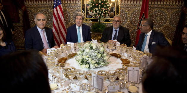 (L-R) Moroccan Foreign Minister Salaheddine Mezouar, U.S. Secretary of State John Kerry, Moroccan Prime Minister Abdelilah Benkirane and U.S. Ambassador to Morocco Dwight Bush attend a dinner meeting at the Guest Palace Residence in Rabat April 3, 2014. REUTERS/Jacquelyn Martin/Pool (MOROCCO - Tags: POLITICS)