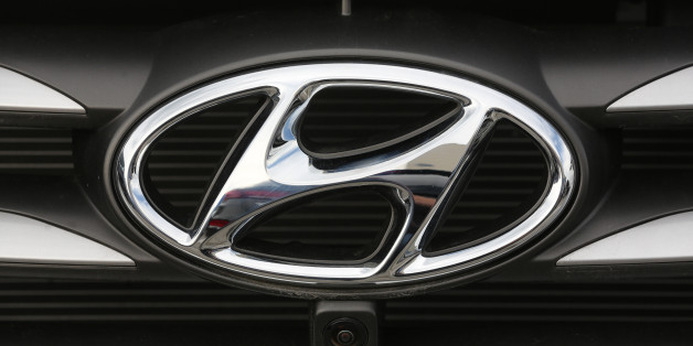 A badge sits on the front grill of an Hyundai Motor Corp. automobile in a parking lot outside the Avtotor auto assembly plant in Kaliningrad, Russia, on Tuesday, Aug. 2, 2016. South Korea's largest automaker expects unfavorable market conditions on Brexit-related uncertainties and continued slowdown in emerging markets, Choi Byung Chul, Hyundai Motor Corp.'s chief financial officer, said on a conference call. Photographer: Andrey Rudakov/Bloomberg via Getty Images