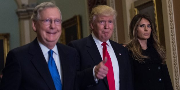 US President-elect Donald Trump (C) walks with his wife Melania Trump, and Senate Majority Leader Mitch McConnell (R-KY) on Capitol Hill in Washington,DC on November 10, 2016. / AFP / NICHOLAS KAMM        (Photo credit should read NICHOLAS KAMM/AFP/Getty Images)