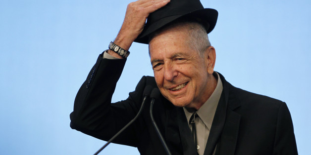 Musician Leonard Cohen tips his hat to the audience as he accepts the 2012 Awards for Song Lyrics of Literary Excellence, which was awarded to both he and Chuck Berry at the John F. Kennedy Presidential Library and Museum, in Boston, Massachusetts, U.S. on February 26, 2012.   REUTERS/Jessica Rinaldi/File Photo