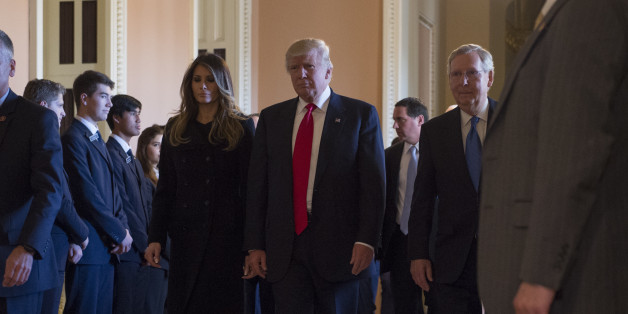 President-elect Donald Trump and his wife Melania walk with Senate Majority Leader Mitch McConnell of Ky. on Capitol Hill in Washington, Thursday, Nov. 10, 2016, after their meeting. (AP Photo/Molly Riley)
