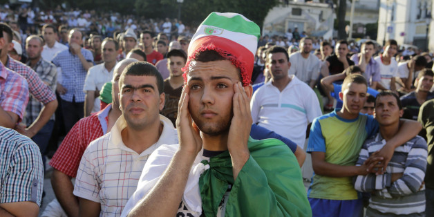 Algerian fans react while watch their team play Belgium during their 2014 World Cup Group H soccer match at a public screening event in Algiers June 17, 2014. REUTERS/Louafi Larbi (ALGERIA - Tags: SPORT SOCCER WORLD CUP)