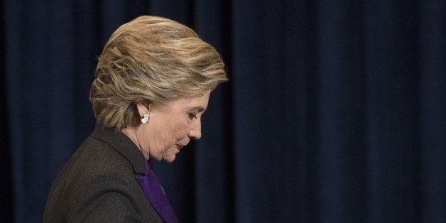 Democratic presidential candidate Hillary Clinton walks off the stage after speaking in New York, Wednesday, Nov. 9, 2016. Clinton conceded the presidency to Donald Trump in a phone call early Wednesday morning, a stunning end to a campaign that appeared poised right up until election day to make her the first woman elected U.S. president.(AP Photo/Matt Rourke)