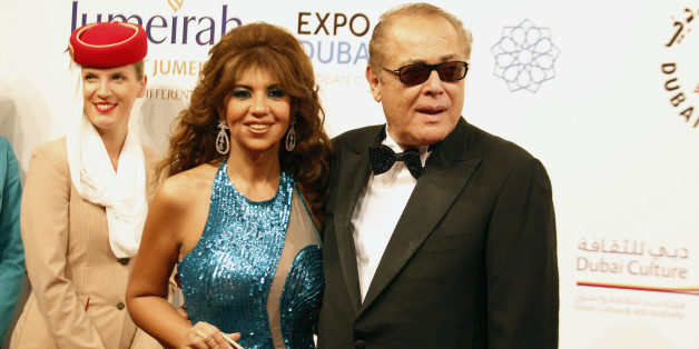 """Egyptian actor Mahmoud Abdel Aziz (R) arrives with wife actress Poussy Chalabi for the opening ceremony of the 9th Dubai International Film Festival, as well as the gala screening of """"Life of Pi"""", at Madinat Jumeirah in Dubai December 9, 2012. REUTERS/Jumana El Heloueh (UNITED ARAB EMIRATES - Tags: ENTERTAINMENT)"""