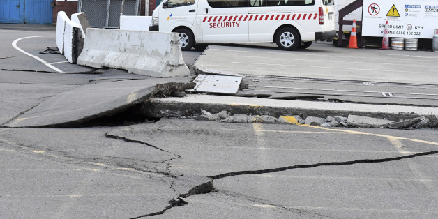 Fissures run along a road by the Centre Port in Wellington, Monday, November 14, 2016, after a major earthquake struck New Zealand's south Island early Monday.  A powerful earthquake struck in a mostly rural area close to the city of Christchurch but appeared to be more strongly felt in the capital, Wellington, more than 200 Km (120 miles) away. (Ross Setford/SNPA via AP)