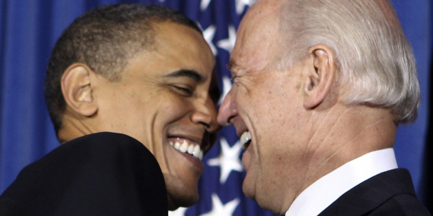U.S. President Barack Obama (L) and Vice President Joseph Biden attend a rally celebrating the passage and signing into law of the Patient Protection and Affordable Care Act health insurance reform bill while at the Interior Department in Washington March 23, 2010.     REUTERS/Larry Downing  (UNITED STATES - Tags: POLITICS)