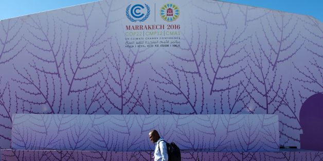 A man walks past the logo of the COP22 international climate conference on November 9, 2016, in Marrakesh. / AFP / FADEL SENNA        (Photo credit should read FADEL SENNA/AFP/Getty Images)