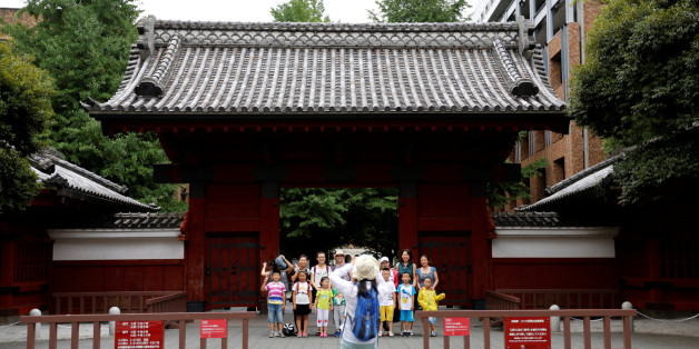 People pose for a photo in front of Akamon Gate at the University of Tokyo in Tokyo, Japan July 20, 2016.  REUTERS/Toru Hanai     AUNIV
