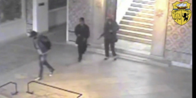 In this frame made from CCTV and released by the Tunisian government on Saturday March 21 2015, two gunmen and third unidentified man can be seen inside the Bardo museum in Tunis, on Wednesday, March 18, 2015. Two Tunisians trained in neighbouring Libya opened fire in the museum Wednesday, killing 21 people before they died in a shootout with security forces.  (AP Photo / Tunisian Interior Ministry)