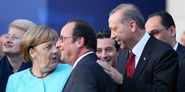 WARSAW, POLAND - JULY 8:   German Chancellor Angela Merkel, President of France Froncois Hollande (C) and Turkish President Recep Tayyip Erdogan chat during the Warsaw NATO Summit on July 8, 2016 in Warsaw, Poland.  (Photo by Dursun Aydemir/Anadolu Agency/Getty Images)