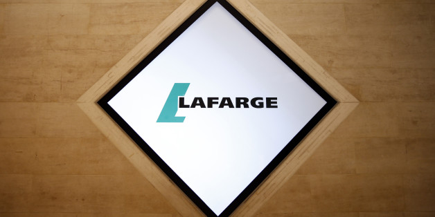 The company logo of Lafarge is pictured during the group's shareholders meeting in Paris, France, May 7, 2015. Holcim Ltd, a Swiss company, and Lafarge S.A., which is based in Paris, on Monday won U.S. antitrust approval to merge after they agreed to divest assets, the Federal Trade Commission. The companies agreed to divest plants, terminals and a quarry to gain approval of their $25 billion deal, the FTC said. REUTERS/Benoit Tessier
