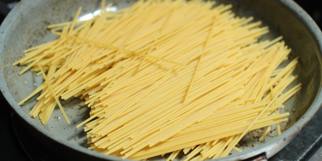 This June 22, 2015 photo shows the preparation of pasta for breakfast for dinner spaghetti in Concord, N.H. This dish is from a recipe by Sara Moulton. (AP Photo/Matthew Mead)