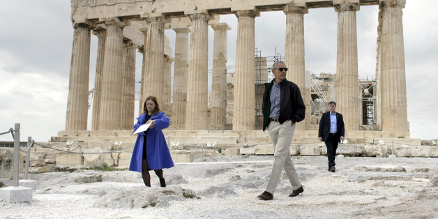 US President Barack Obama (R) walks in front of the Parthenon during a tour of the Acropolis on November 16, 2016 in Athens, Greece.