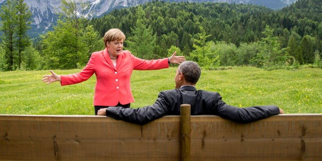 Germany's Chancellor Angela Merkel (L) gestures while chatting with US President  Barack Obama sitting on a bench outside the Elmau Castle after a working session of a G7 summit near Garmisch-Partenkirchen, southern Germany, on June 8, 2015. AFP PHOTO / POOL / MICHAEL KAPPELER / AFP / POOL / MICHAEL KAPPELER        (Photo credit should read MICHAEL KAPPELER/AFP/Getty Images)