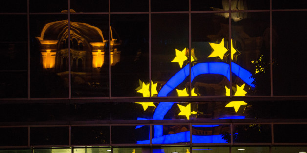 The euro sign sculpture is reflected in office windows as it stands outside the former European Central Bank (ECB) headquarters in Frankfurt, Germany, on Monday, July 4, 2016. The British seat at the European Union summit had been empty for less than 24 hours before leaders from France and Germany were haggling over one of the U.K. economy's crown jewels: the business that facilitates trading in euro-denominated derivatives. Photographer: Krisztian Bocsi/Bloomberg via Getty Images